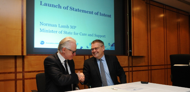Norman Lamb MP and Otto Thoresen shake hands after signing the Statement of Intent